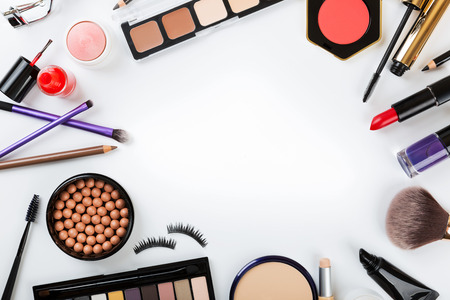 top view of cosmetics on white with copy space Stockfoto