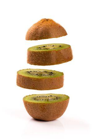 levitate: kiwi slices levitating on white background