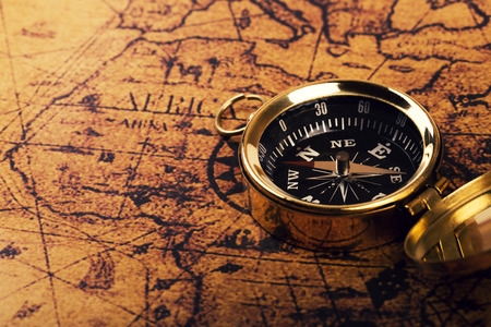 old compass on vintage world map Stockfoto