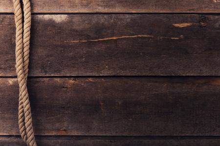 Vintage achtergrond met oude touw op houten planken Stockfoto