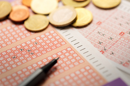 mark pen: lottery tickets with coins and pen Stock Photo
