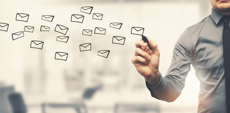 sending email concept - businessman drawing envelopes in offiice Foto de archivo