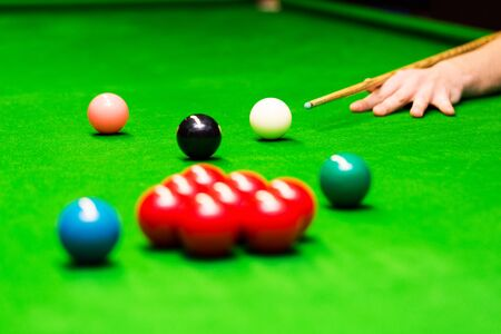 snooker - hand aiming the cue ball Stock Photo