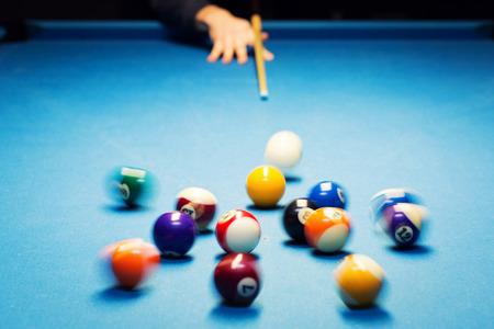 games hand: pool billiard break shot. motion blur