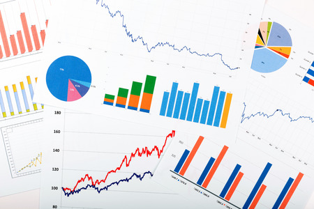 business finance analytics - papers with graphs and charts Foto de archivo