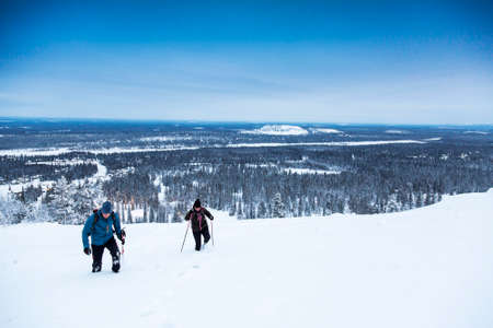 winter hiking on snow covered mountain. Luosto, Finland