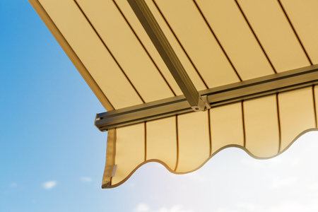sun protection - awning against blue sky Stockfoto