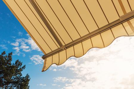 awning against blue sunny sky Stock Photo