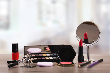 makeup cosmetics on table in beauty salon