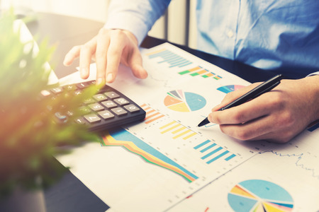 financial reports: man analyzing and working on business financial reports in office Stock Photo