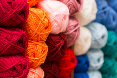 closeup of colorful wool yarn balls in knitting store Stock Photo