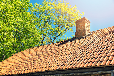 roof tile against blue sky on sunny day