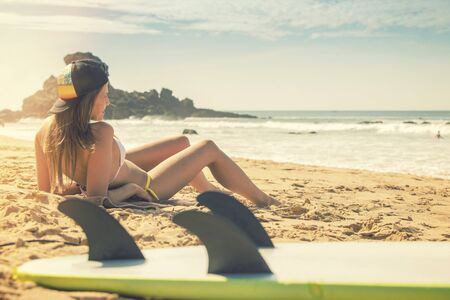 surfer girl lying on the beach and watching to the ocean. Praia Castelejo Portugal photo