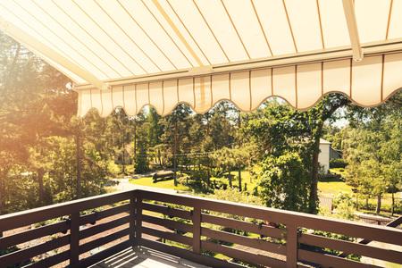 sunshade: awning over balcony terrace on sunny day