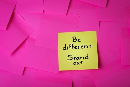 be different stand out text on yellow sticky note Stok Fotoğraf