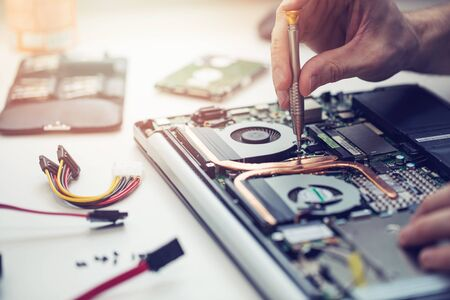 technician repairing laptop computer closeup Stockfoto