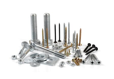 Variety of screws and fasteners isolated on white background
