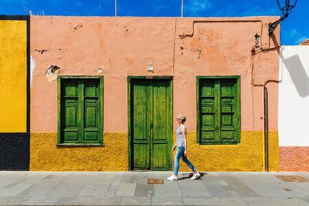 woman walk Puerto de la Cruz city streets. Tenerife Spain Stock Photo