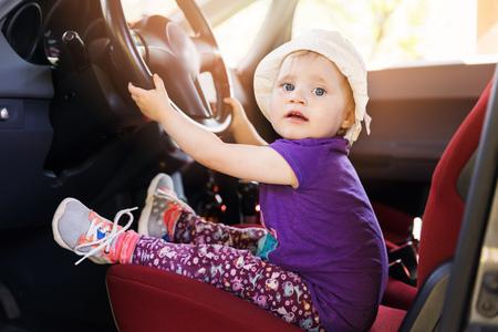 cute little child steering wheel in the car