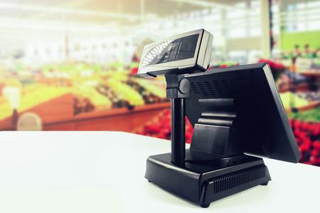 cash register on desk at grocery store Imagens