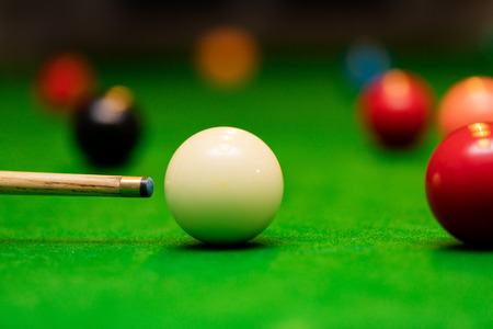 snooker game - player aiming the cue ball