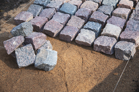 cobblestone paving - granite stone pavers on the gravel Stockfoto