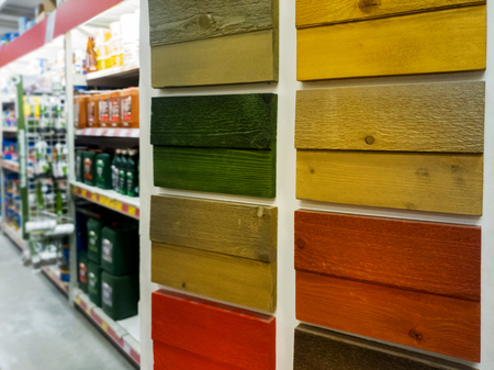 choosing wood protection paint color in building materials shop Stock Photo