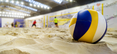 indoor beach volleyball. ball in sand with copy space