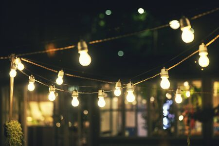 outdoor party string lights glowing at night 版權商用圖片 - 130353742
