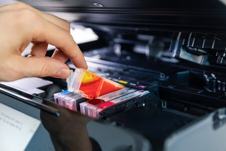 office equipment maintenance and service - hand replace inkjet printer cartridge