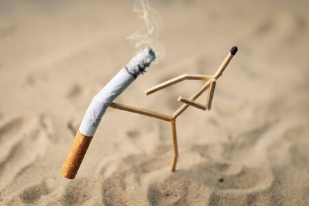 stop smoking concept - match man kick off a burning cigarette