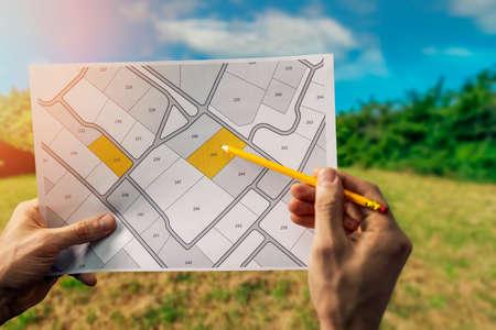 sale of building plot of land for house construction. cadastral map on field background Reklamní fotografie