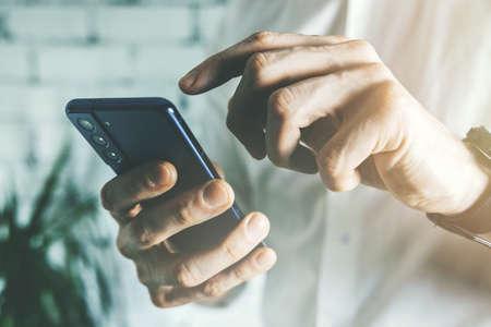business man using smart phone in office. closeup Standard-Bild