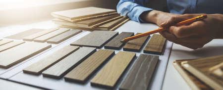 wooden texture furniture material samples for interior design. designer working in office. banner Standard-Bild