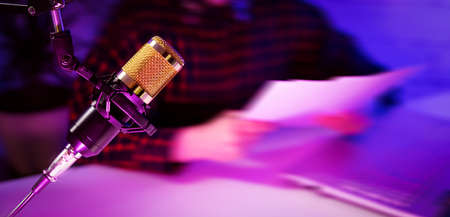 microphone closeup in podcast studio. banner copy space