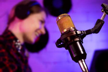 podcaster radio host working in studio. microphone closeup