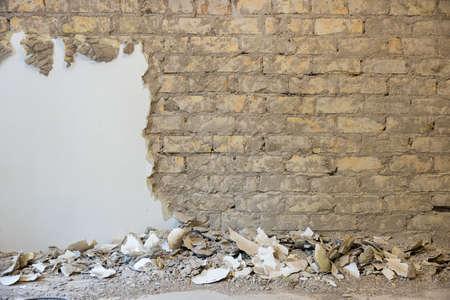 old brick wall restoration. plaster removal Standard-Bild