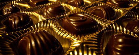 golden box with chocolate candies. banner