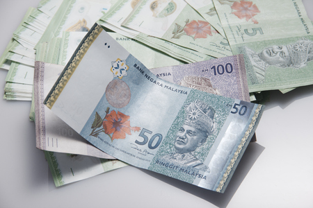 Malaysia Bank Notes with RM50 & RM100 as main objects and RM5 as background