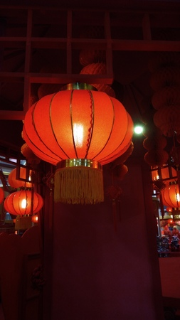 Red Lantern Hang on Ceiling with few at the background Stock Photo