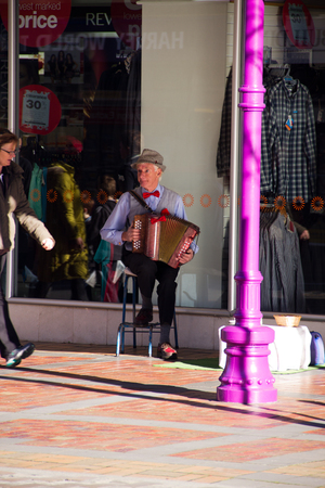 TIMARU, NEW ZEALAND, 04 JUNE 2017: Street artist playing accordion infront of a shop