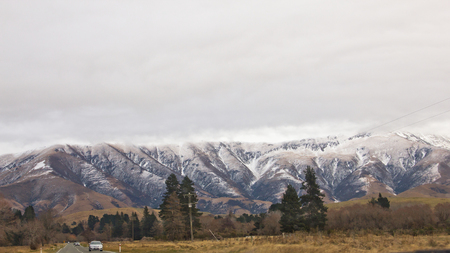 Snow melting view at New Zealand with cars