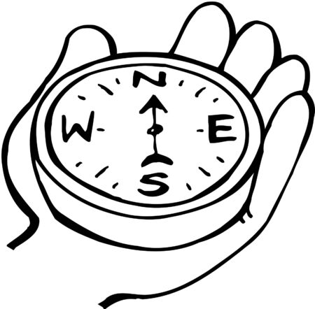 Hand holding compass