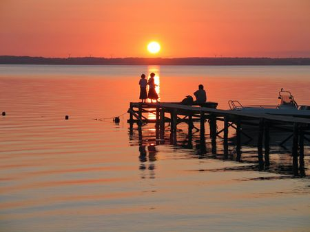 People on a dock in sunset in  a camping site in Langeland Denmark