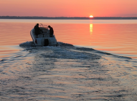 Speedboat sails into the sunset