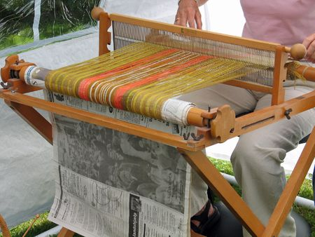 weft: Weaving lamb wool with a traditional loom Stock Photo