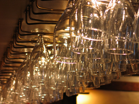 Rack with lines of glasses in a bar pub photo