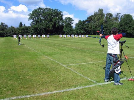 An official target shooting  archer aim and shoots