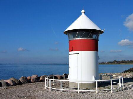 Port lighthouse at the port of Assens Denmark photo