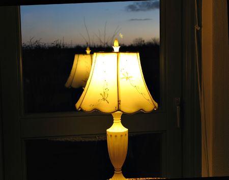lamp window: Reflection of a decorative night lamp on a window